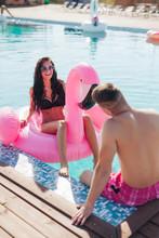 Girl In Pool Talking To Man In...