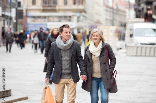 Senior couple shopping in centre of the city. Winter Canvas Print