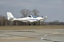A Light Aircraft Above Runway
