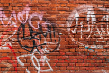 Red Brick Wall With Graffiti I...