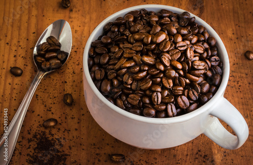 Fototapeta  Whole Coffee Beans in a White Coffee Cup