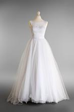 Made-up Wedding Dress On Mannequin Against Grey Background