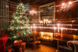 Christmas magic and fairy tale evening by candlelight. classic apartments with a white fireplace, decorated tree, sofa, large windows chandelier.