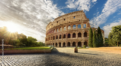 Poster Rome Colosseum in Rome and morning sun, Italy