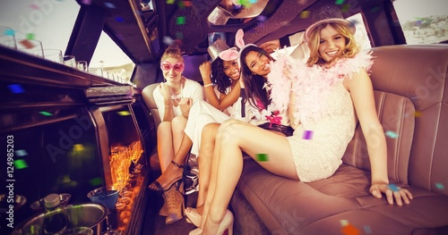 Composite image of portrait of female friends in limousine Poster Mural XXL