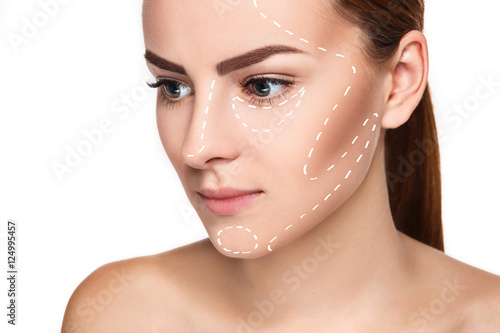 Obraz The beautiful woman face with arrows close up over white background - fototapety do salonu