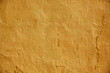canvas print picture - yellow painted stone wall surface