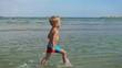 Little boy having fun on the beach, Constanta, Romania