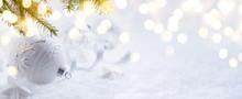 Art Christmas Decoration And Holidays Light On Snow Background