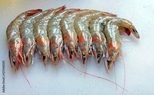 Raw shrimp, on cutting board