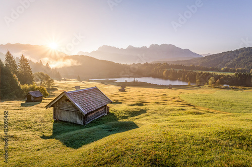 Canvastavla View over Geroldsee with wooden hut and Karwendel mountains at morning, Bavaria,