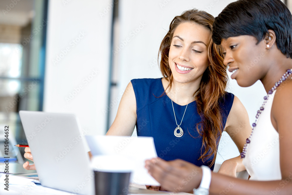 Fototapeta Women working together, office interior