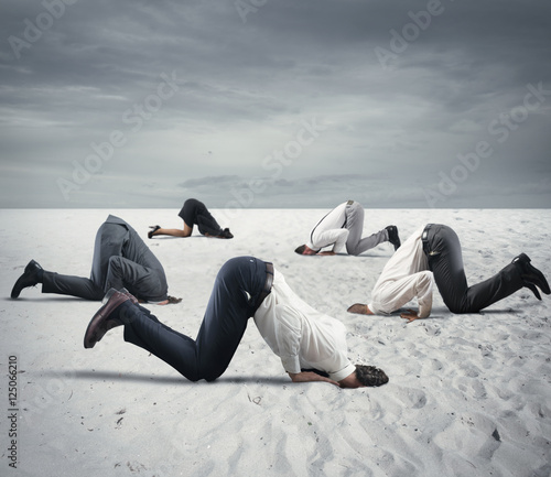 Fotografie, Obraz  Fear of crisis with businesspeople like an ostrich