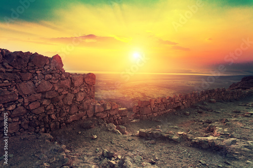 Poster de jardin Cappuccino Beautiful sunrise over Masada fortress. Ruins of King Herod's palace in Judaean Desert.