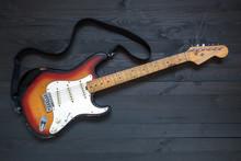 Vintage Guitar On Black Toned Wooden Board
