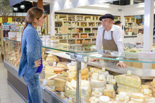 Woman At French Cheese Counter