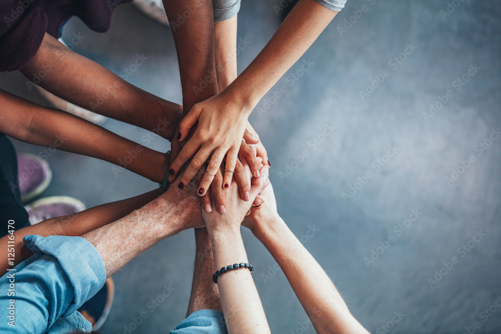 Fototapety, obrazy: Stack of hands showing unity and teamwork