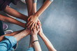 canvas print picture Stack of hands showing unity and teamwork