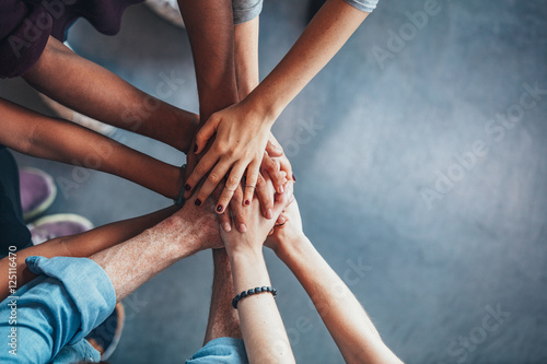 Valokuva  Stack of hands showing unity and teamwork