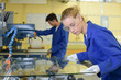 Leinwanddruck Bild - Young people in glass factory