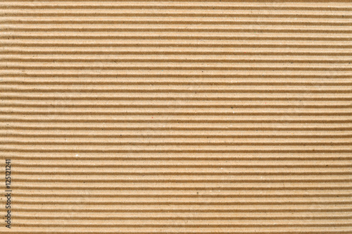 Foto  Brown corrugated cardboard useful as a background