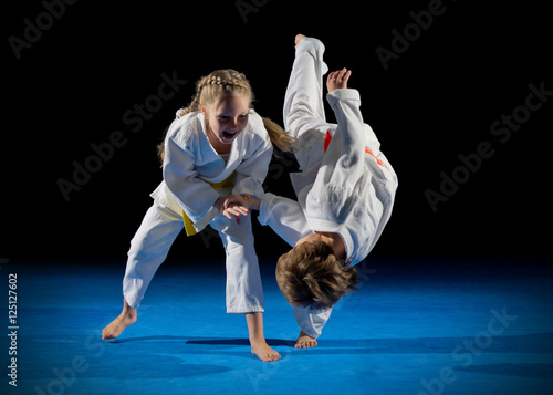 Fotobehang Vechtsport Children martial arts fighters