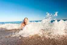 Happy Young Girl Enjoying In Sea Splashing Waves. Mediterranean