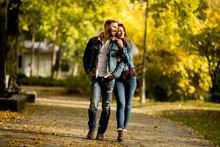 Couple Walking In The Autumn Park
