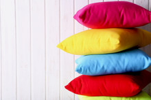 Colorful Pillows On A White Wa...