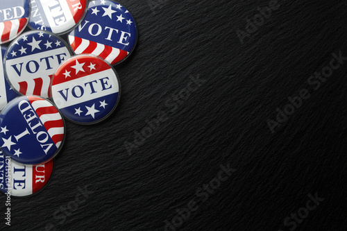 Fototapeta  Red, white, and blue vote buttons background