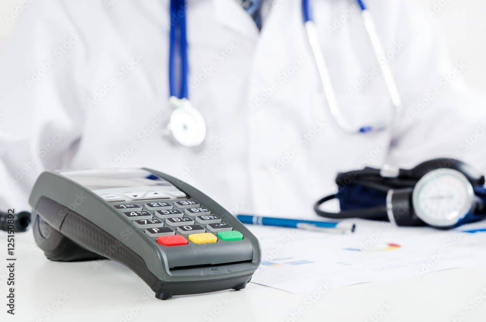 Fototapeta Payment terminal in doctor's office. Pay for health care