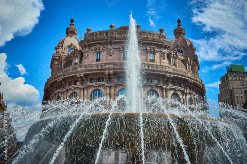 "Fotografie, Obraz  ""Palazzo della Borsa"" and great fountain at central Place in Genoa / Historical"