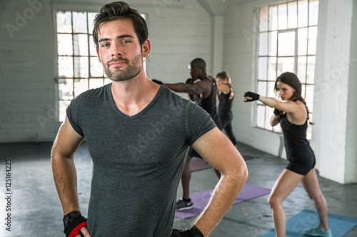 Strong Intense Pose By Handsome Personal Trainer With Team Class Cardio Workout