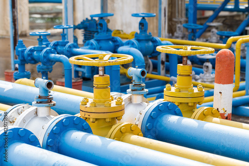 Valves at gas plant, Pressure safety valve selective focus. Wallpaper Mural