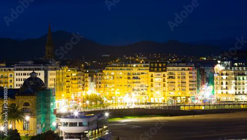 Poster Oceanië View of La Concha Embankment in night at San Sebastian