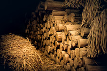 Firewood Logs With Straw In Hut.
