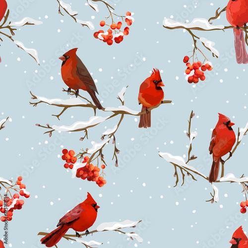 czerwone-ptaki-siedzace-na-galeziach-ze-sniegiem