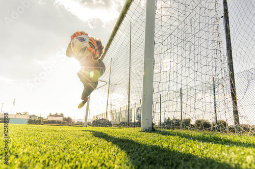 Goalkeeper catches the ball at the stadium Canvas Print