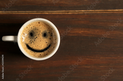 Spoed Foto op Canvas koffiebar Good morning coffee smile cup on wooden background