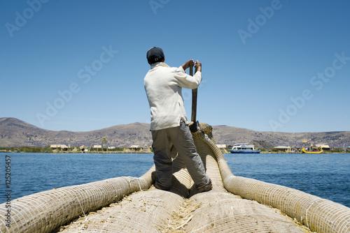 Foto op Canvas Cathedral Cove Reed Boatman of Lake Titicaca, Uros Islands, Peru