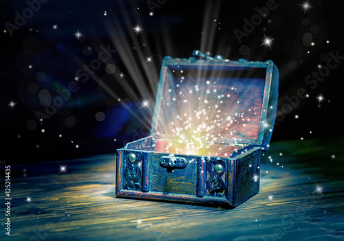 Photo  close up concept greeting card of opened vintage chest treasure