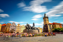 View On The Old Town Square With The Famous Clock Tower In Prague City. Long Exposure Image Technic With Blurred People And Clouds