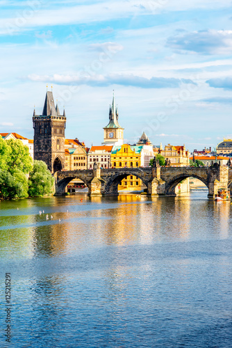 Staande foto Praag Citycsape view on the riverside with the bridge and old town in Prague
