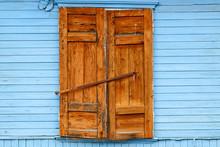 Wooden Window Shutters Closed. Blue House Wall