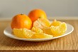 The fresh tangerines on a plate