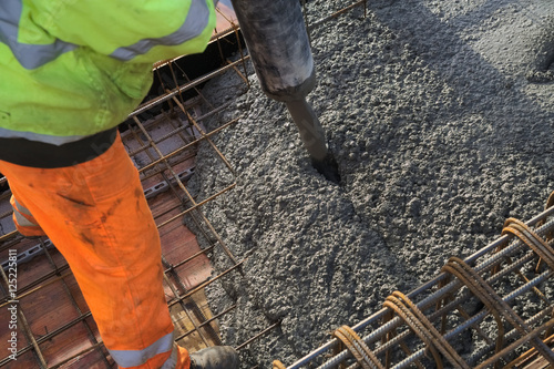 Foto op Canvas Jacht Concreting of slab pouring concrete engineering construction with rebar and formwork