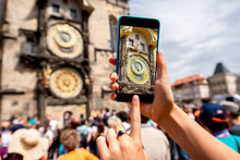 Photographing With Smart Phone A Famous Astronomical Clock On The Town Hall In Prague City