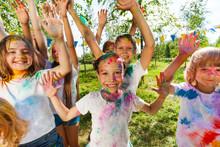 Portrait Of Bright Kids Smeared In Colored Powder