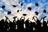 Fototapeta Tęcza - Students graduate cap throwing in sky