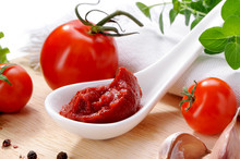 Tomato Paste In Porcelain Spoon Close-up With Sauce Ingredients